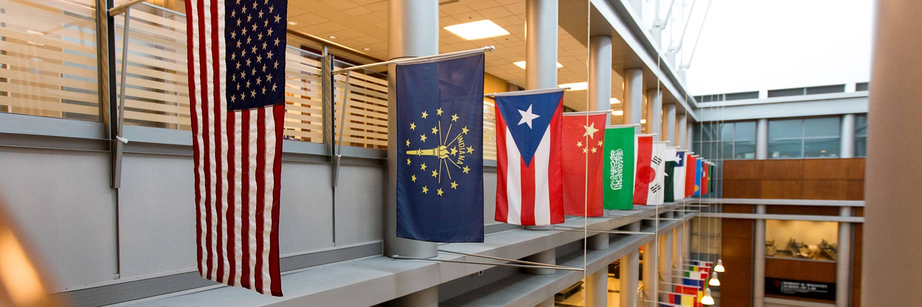 International flags hanging from the IUPUI Campus Center balcony