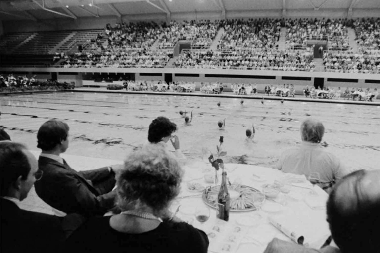 An audience in the Natatorium watches the Classic Splash synchronized swimming
