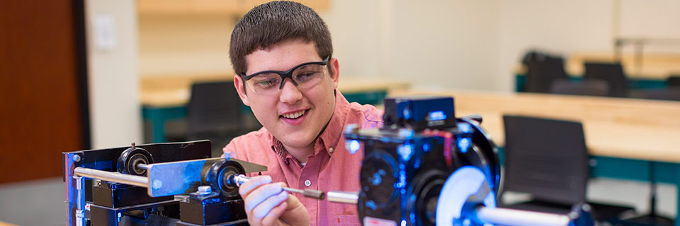 Male IUPUI student learns with engineering technology