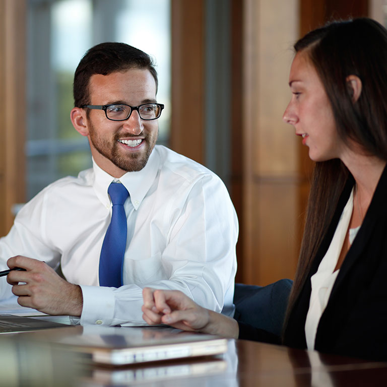 A student works with an academic advisor.