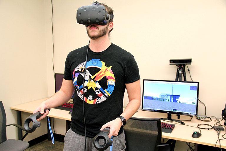 Senior Hayden Bailey wears a virtual reality headset.