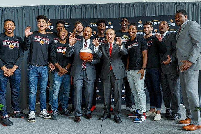 IUPUI Chancellor Paydar, basketball team and coaches.