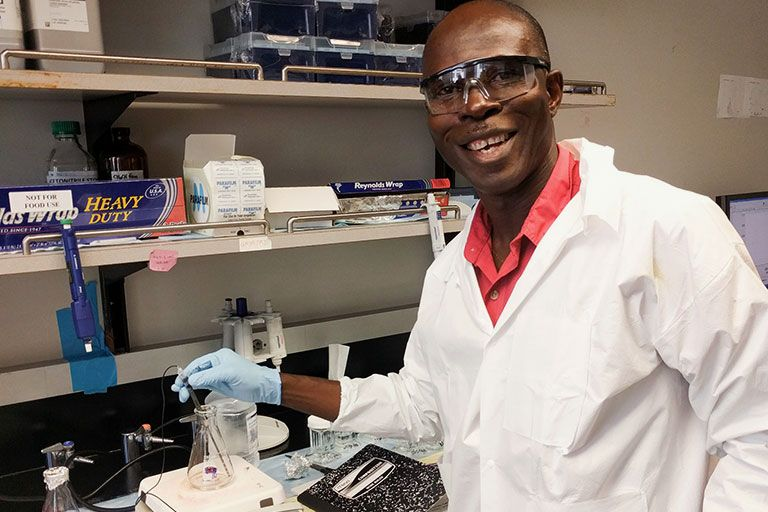 Hector Oyem-Erasmus, graduate student from Newcastle University, in the lab