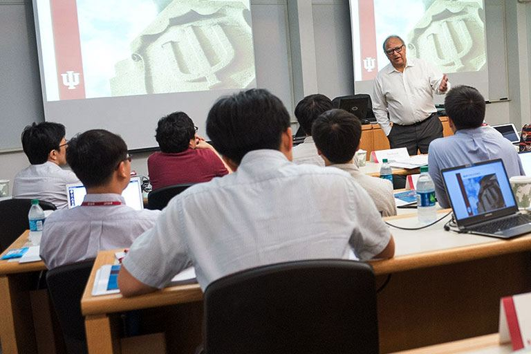 Business professor speaks to classroom of students