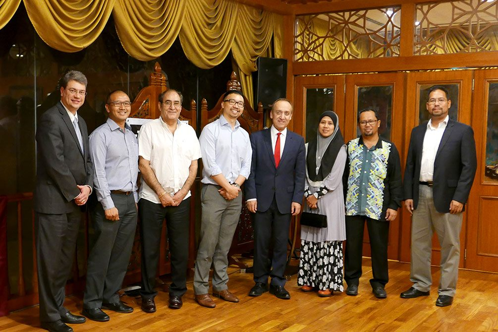 Dean Russomanno, Ali Jafari and Chancellor Paydar pose with IUPUI alumni in Malaysia