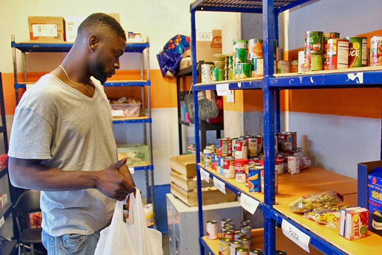 IUPUI senior Reginald Anderson selects some food items at Paw's Pantry