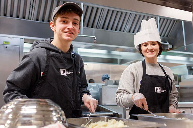 Students prepare food in the IUPUI Campus Kitchen