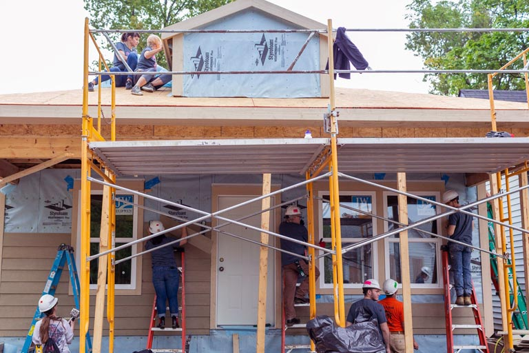 A crew works on a Habitat for Humanity house.