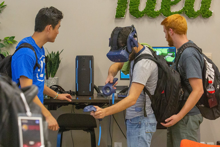 Students examine virtual reality devices in the Idea Garden.