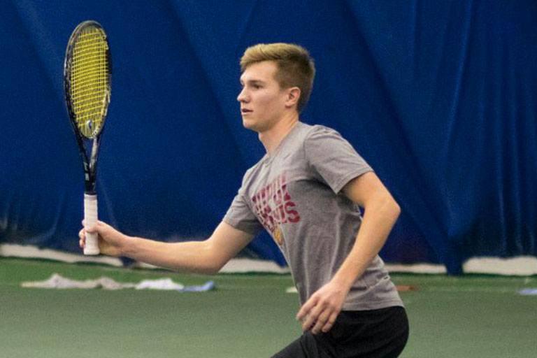 Matt Moe playing tennis
