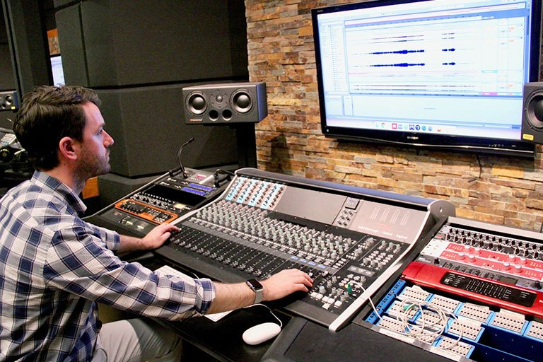 Jordan Munson at the sound mixing board