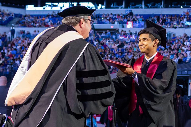 Naqeeb Rahman received his diploma cover at commencement.