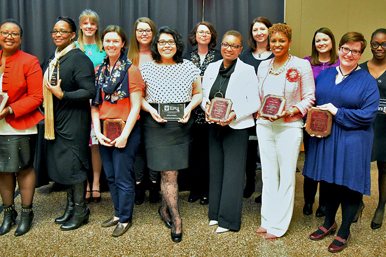 Women's History Month Leadership Awardees with their awards