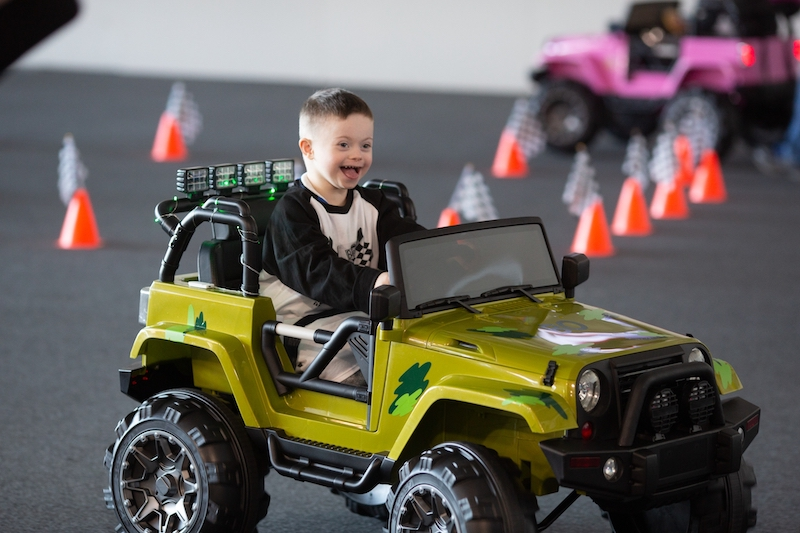 A child rides a modified vehicle from the Go Baby Go program.