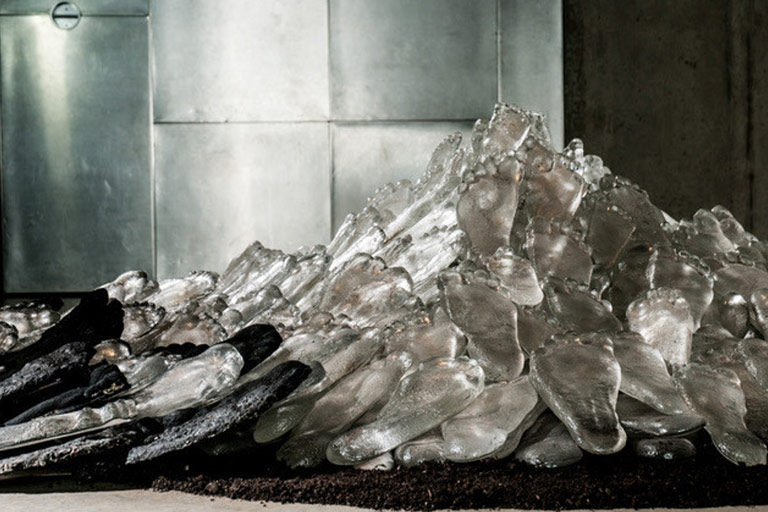 An art installation of glass and concrete footprints