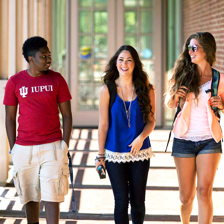 Three IUPUI students smiling and talking