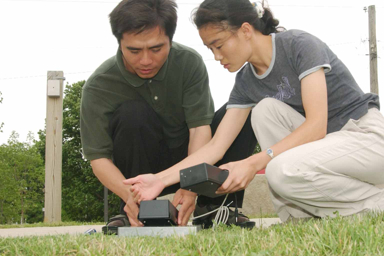 Two researchers doing soil and water testing